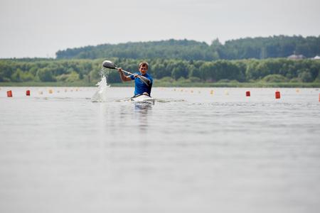 Kayker paddling on the lake