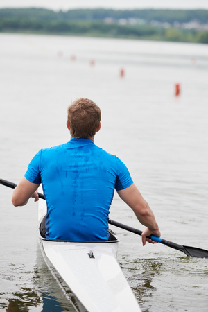 Young man kayaking 写真素材