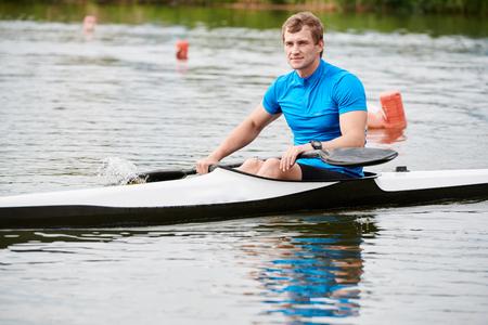 Man floating on kayak