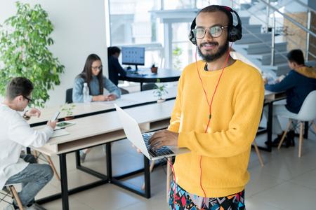 Male designer using laptop
