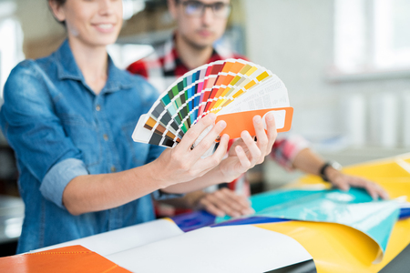 Crop coworking designers choosing colors Standard-Bild