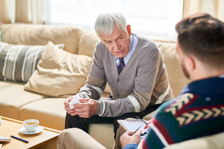 Old Man in Therapy Session Stock Photo