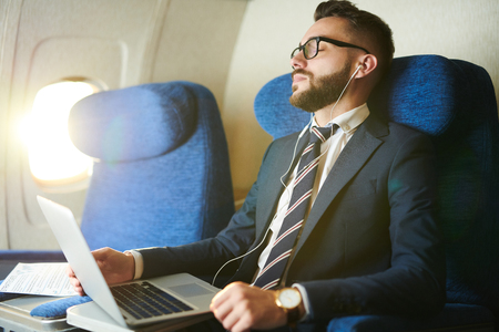 Businessman Napping in Plane