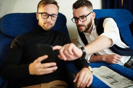 Two Handsome Men Using Smartphone Stock fotó - 108969261