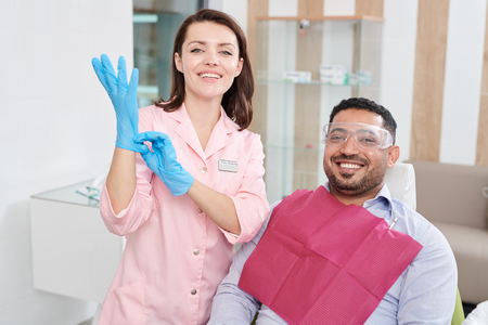 Smiling Female Dentist Posing with Patient Stock Photo - 108969572