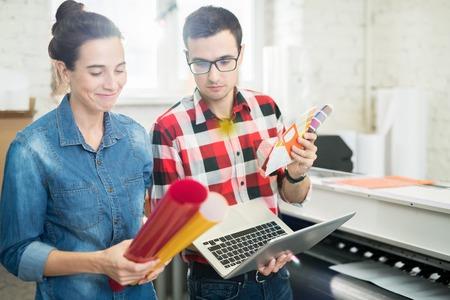 Designers choosing color of printing paper