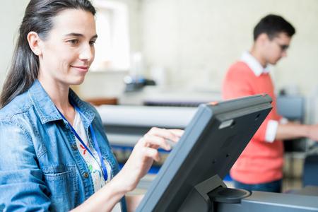 Content lady choosing settings of printing