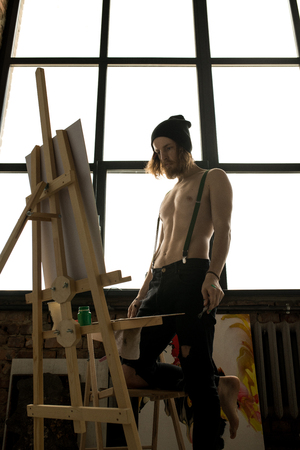 Contemporary Artist Looking at Painting