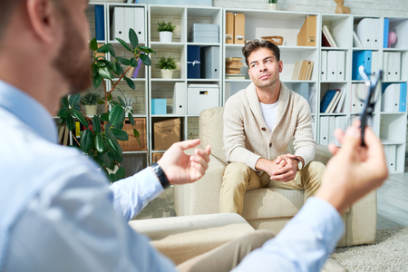 Patient with faraway look at therapy session