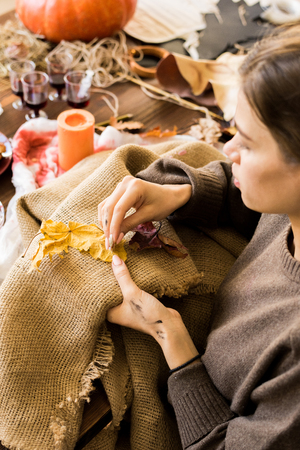 Busy woman sewing burlap in workshop