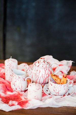 Tea crockery in blood Stock Photo