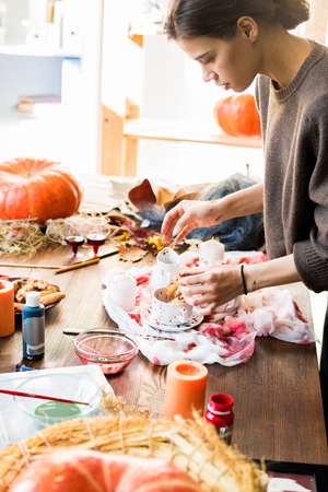 Creative designer choosing Halloween decoration placement for sh