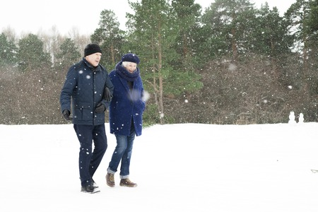 Senior Couple in Winter Forest Stock Photo