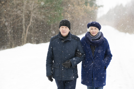 Retired Couple in Winter Forest Stock Photo
