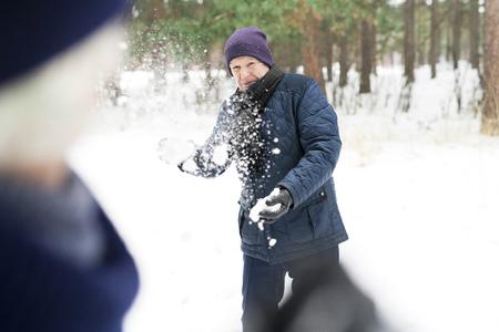 Senior Man in Snowball Fight