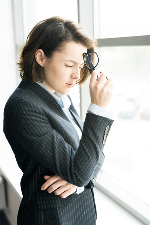 Puzzled business lady recollecting information