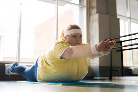Obese Young Woman Working Out