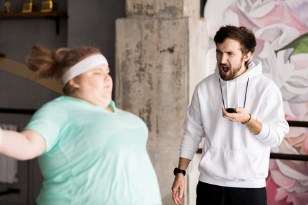 Angry Coach Training Obese Woman