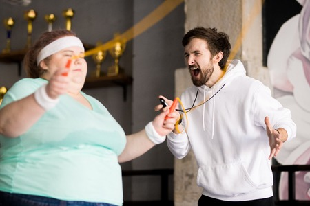 Angry Coach Yelling at Obese Woman