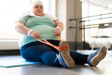 Obese Woman Training in Fitness Class