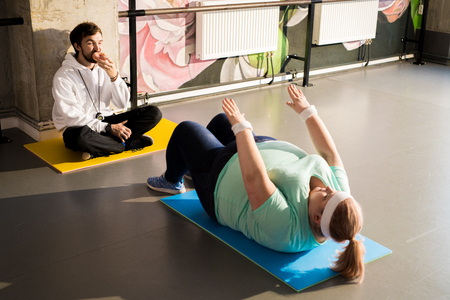 Obese Woman Working Out Stock Photo
