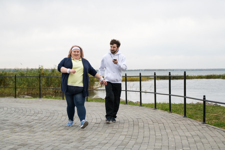 Obese Woman Jogging Outdoors