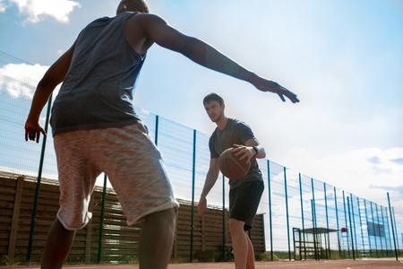 Two Men Playing Basketball