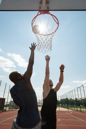 Two Basketball Players Outdoors Stock Photo