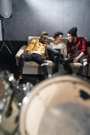 Three Young People Chilling in Studio