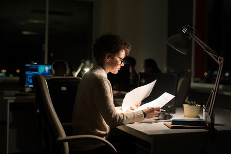 Woman Working at Night Imagens