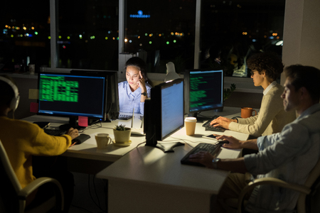 Computer Programmers Coding at Night