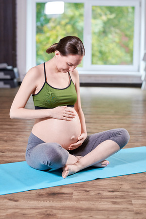 Pregnant Woman Caressing Belly