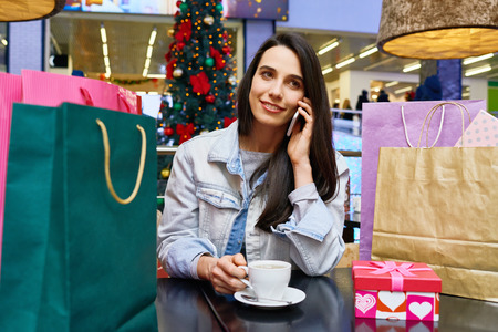 Woman drinking coffee after shopping
