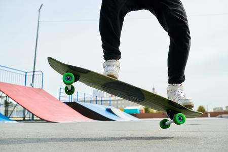 Unrecognizable Man Jumping on Skate Imagens