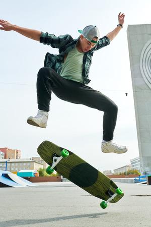Young Man doing Skating Stunts