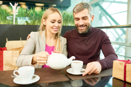 Couple Drinking Tea in Cafe Stock Photo