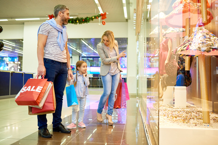 Family Looking at Window Displays