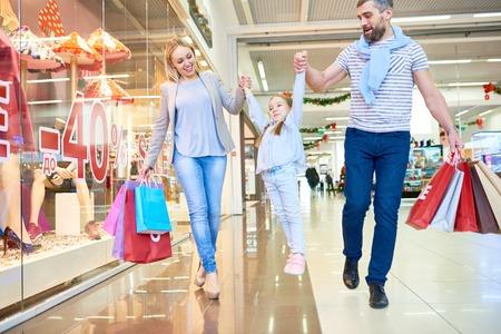 Playful Family Enjoying Shopping