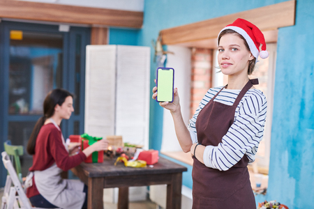 Female Artist Holding Smartphone