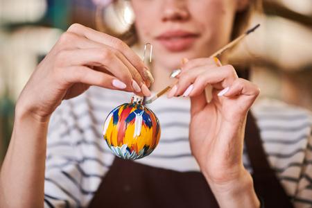 Woman Painting Christmas Ornament Closeup 版權商用圖片
