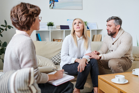 Husband trying to get along with wife at therapy session
