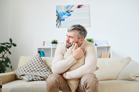 Sad man crying while dealing with personal issues at therapy