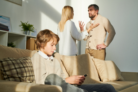 Boy being closed off while parents having quarrel