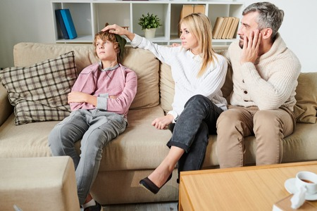 Parents worrying about teenage son Stock Photo