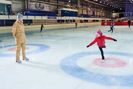 : Child Learning to Ice Skate
