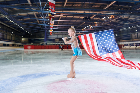 Girl Figure-Skating Carrying American Flag
