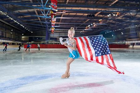 Girl Figure-Skating with American Flag Banco de Imagens