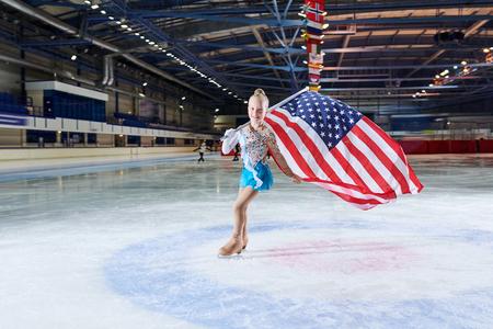 Little Girl Figure-Skating with American Flag Banco de Imagens