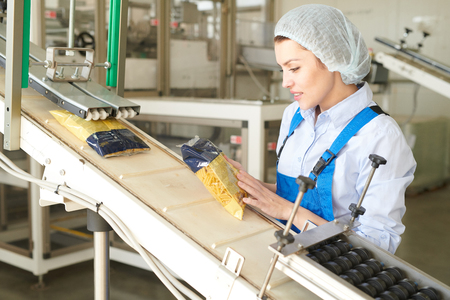 Young Woman Working at Packaging Line