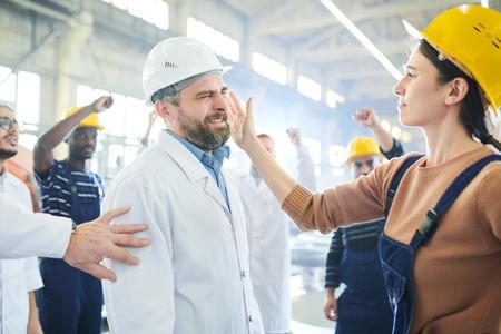 Female Worker Slapping Boss on Face